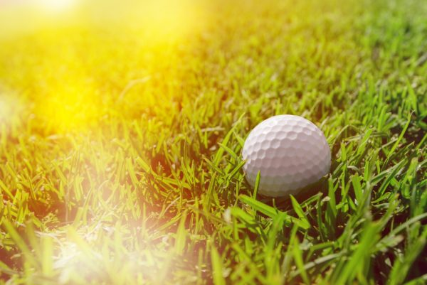 white golf ball and sunbeams on it,