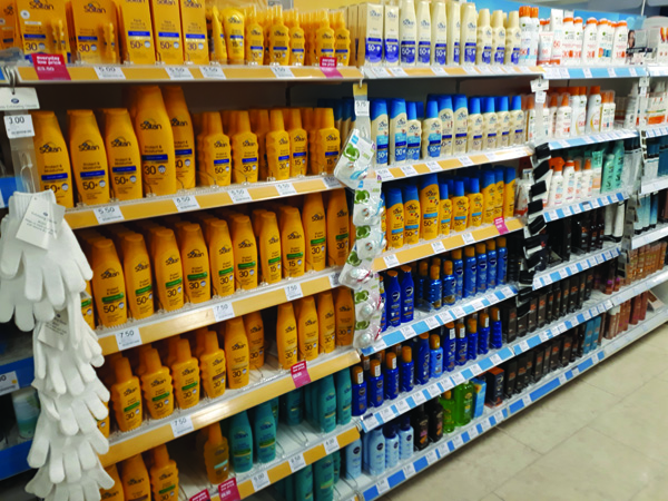 Shop shelf with sun cream